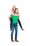 Attractive girl and handsome guy. Young couple on white. Royalty Free Stock Image