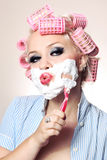 Attractive girl is having a shave. Attractive girl is shaving face royalty free stock image