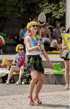 Attractive girl with Hawaiian garlands, playing Badminton. Szczecin, Poland - Mai 23, 2014: Juwenalia, is an annual students' holiday in Poland, usually Royalty Free Stock Photos
