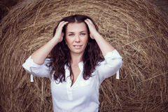 Attractive girl in hay Royalty Free Stock Photography