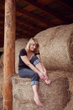 Attractive girl in hay Stock Photo