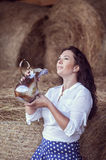 Attractive girl in hay Stock Images