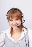 Attractive girl in headphones with microphone Royalty Free Stock Photography