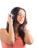 Attractive girl with headphones Royalty Free Stock Photos