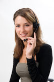 Attractive girl with headset. Young beautiful girl with headphones with microphone in call center Stock Photos