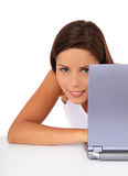 Attractive girl hiding behin laptop Stock Images