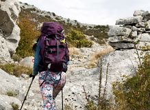 Attractive girl hiking. Young attractive girl hikingng on rocky mountin Stock Photography