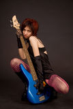 Attractive girl holding bass guitar Stock Image