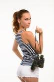 Attractive girl holding binocular. Stock Image