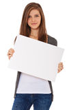 Attractive girl holding blank sign. Attractive teenage girl holding blank sign. All on white background Stock Image
