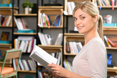 Attractive girl holding a book Royalty Free Stock Photo