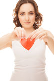 Attractive girl holding broken paper red valentine heart focus o Royalty Free Stock Photo