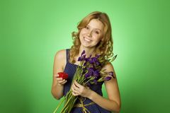 Attractive girl holding flowers and a gift box Royalty Free Stock Photos