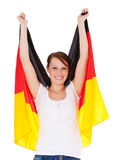Attractive girl holding german flag Royalty Free Stock Images