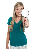 Attractive girl holding magnifying glass Stock Photography