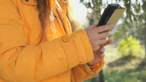 The attractive girl holding a mobile phone stock footage