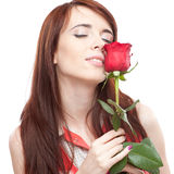 Attractive girl holding red rose Royalty Free Stock Image