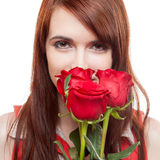 Attractive girl holding red roses Royalty Free Stock Photography