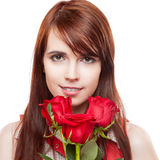 Attractive girl holding red roses Stock Image