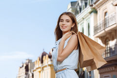 Attractive girl holding shopping bags Royalty Free Stock Image