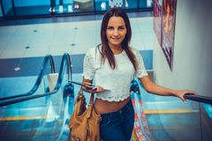 Attractive girl holding silver computer tablet Stock Photography