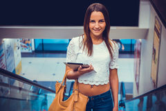 Attractive girl holding silver computer tablet Stock Image
