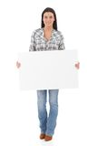 Attractive girl holding a white panel smiling Stock Photos