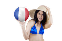 Attractive girl holds ball with flag of France Royalty Free Stock Photos