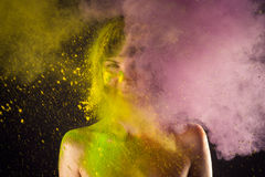 Attractive girl in Holi colors on a black background Royalty Free Stock Image