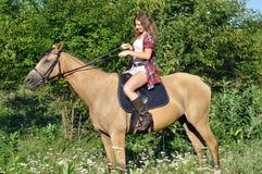 Attractive girl horseback riding Stock Photo