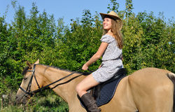 Attractive girl horseback riding Royalty Free Stock Photography