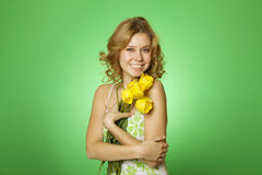 Attractive Girl Hugging A Bouquet Of Yellow Tulips Stock Photo