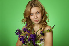 Attractive girl hugging a bouquet of iris Stock Photography