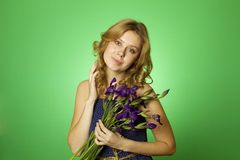 Attractive girl hugging a bouquet of Irises Royalty Free Stock Photos