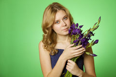 Attractive girl hugging a bouquet of Irises Royalty Free Stock Photography