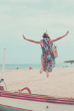 Attractive Girl Jumping on the Beach Having Fun, Summer vacation holiday Lifestyle. Happy women jumping freedom on white Royalty Free Stock Photography
