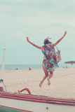 Attractive Girl Jumping on the Beach Having Fun, Summer vacation holiday Lifestyle. Happy women jumping freedom on white Stock Photos