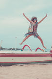 Attractive Girl Jumping on the Beach Having Fun, Summer vacation holiday Lifestyle. Happy women jumping freedom on white Royalty Free Stock Images