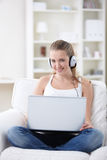 Attractive girl with a laptop Stock Images
