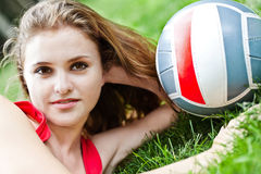 Attractive girl lay on grass Stock Photo