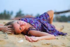Attractive girl laying on beach Royalty Free Stock Photo