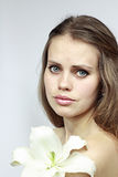Attractive girl with a lily Royalty Free Stock Image