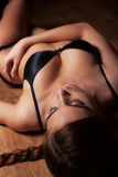 Attractive girl in lingerie on timber floor Royalty Free Stock Photo