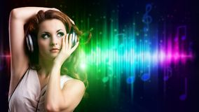 Attractive girl listening to music stock photo