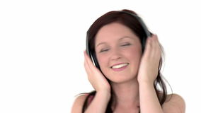 Attractive girl listening to music stock video footage