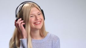 Attractive girl listening to music with headphones stock footage