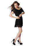 Attractive girl in a little black dress isolated Stock Image