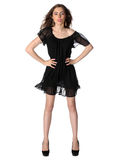 Attractive girl in a little black dress isolated Royalty Free Stock Image