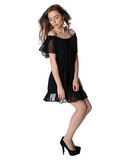Attractive girl in a little black dress isolated Stock Photography