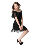 Attractive girl in a little black dress isolated Stock Images